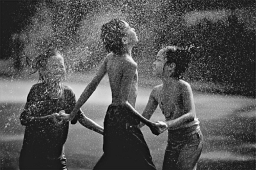 It must have been the first rain after a year-long draught Kids Dancing In The Rain Photography